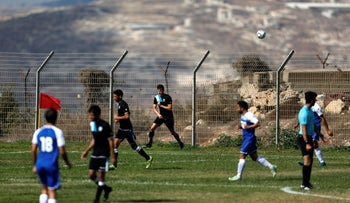 The Ariel Municipal Soccer Club and Maccabi HaSharon Netanya play against each other in the West Bank settlement of Ariel, September 23, 2016.