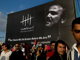 Protesters gather under a banner with a picture of Marwan Barghouti during a rally supporting Palestinian prisoners in Israeli jails, Ramallah, West Bank, May 3, 2017.