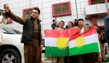 Kurdish parties take pictures with Kurdish flag at the Kirkuk Governorate Council in Kirkuk, Iraq, April 6, 2017.