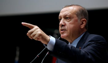 Turkey's President Recep Tayyip Erdogan delivers a speech during a ceremony to rejoin the ruling Justice and Development Party in Ankara, Turkey, May 2, 2017.