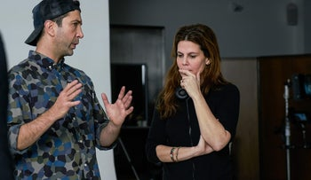 """David Schwimmer and Sigal Avin on the set while making the """"That's Harassment"""" short films."""