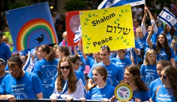 People march along Fifth Ave. during the Celebrate Israel Parade, May 31, 2015, in New York.