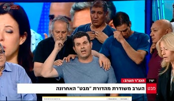 "News anchors and the television crew during the final broadcast of ""Mabat,"" May 9, 2017."