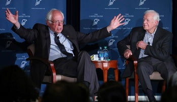 Former President Jimmy Carter, right, and Sen. Bernie Sanders discuss human rights during the Human Rights Defenders Forum at the Carter Center in Atlanta on Monday, May 8, 2017.