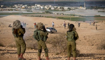 Palestinians and Israeli activists fleeing Israeli soldiers during a demonstration in the West Bank, November 2016.