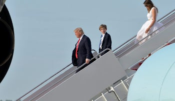 U.S. President Donald Trump, son Barron Trump and first lady Melania Trump disembarking from Air Force One in Maryland, April 2017.