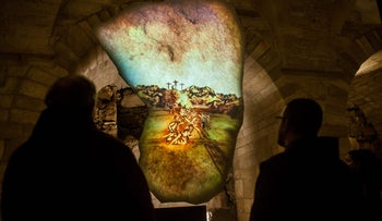 Visitors experiencing the multimedia installation at Terra Sancta Museum, in the Old City of Jerusalem.
