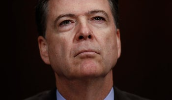 James Comey pauses as he testifies on Capitol Hill in Washington