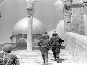 Israeli paratroopers break through the Lions Gate in the Old City to the Dome of the Rock, June 1967.