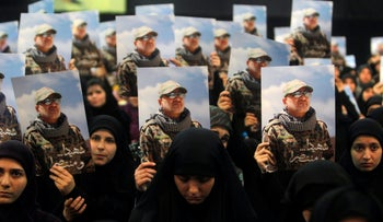 Women carry pictures of Hezbollah commander Mustafa Badreddine, who was killed in an attack in Syria, in a ceremony marking a year after his death in Beirut's southern suburbs, Lebanon May 11, 2017.