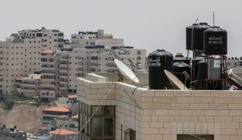 Water tanks on the rooves of homes in East Jerusalem's Shoafat neighborhood.