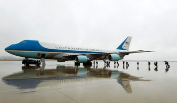 Members of the White House press corps board Air Force One before the arrival of President Donald Trump before departing from a rainy Andrews Air Force Base, Md., Thursday, April 6, 2017.
