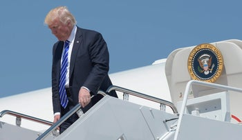 President Donald Trump walks down the steps of Air Force One at Andrews Air Force Base in Maryland, May 17, 2017.