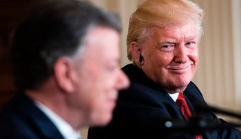 Colombia's President Juan Manuel Santos speaks as U.S. President Donald Trump listens during a press conference in the East Room of the White House May 18, 2017 in Washington, DC