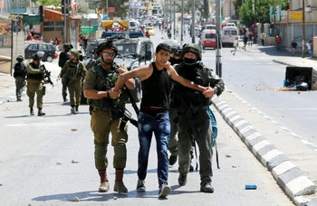 Israeli soldiers detain a Palestinian during clashes following a protest in support of Palestinian prisoners on hunger strike in Israeli jails, in the West Bank town of Bethlehem May 19, 2017.