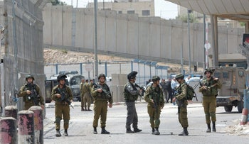 Israeli soldiers at the Qalandiyah checkpoint in the West Bank, 2016.