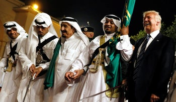 U.S. President Donald Trump dances with a sword as he arrives to a welcome ceremony by Saudi Arabia's King in Riyadh, Saudi Arabia, May 20, 2017.