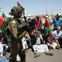 Palestinians rally in solidarity with Palestinian prisoners on hunger strike in Israeli jails, West Bank, May 16, 2017.