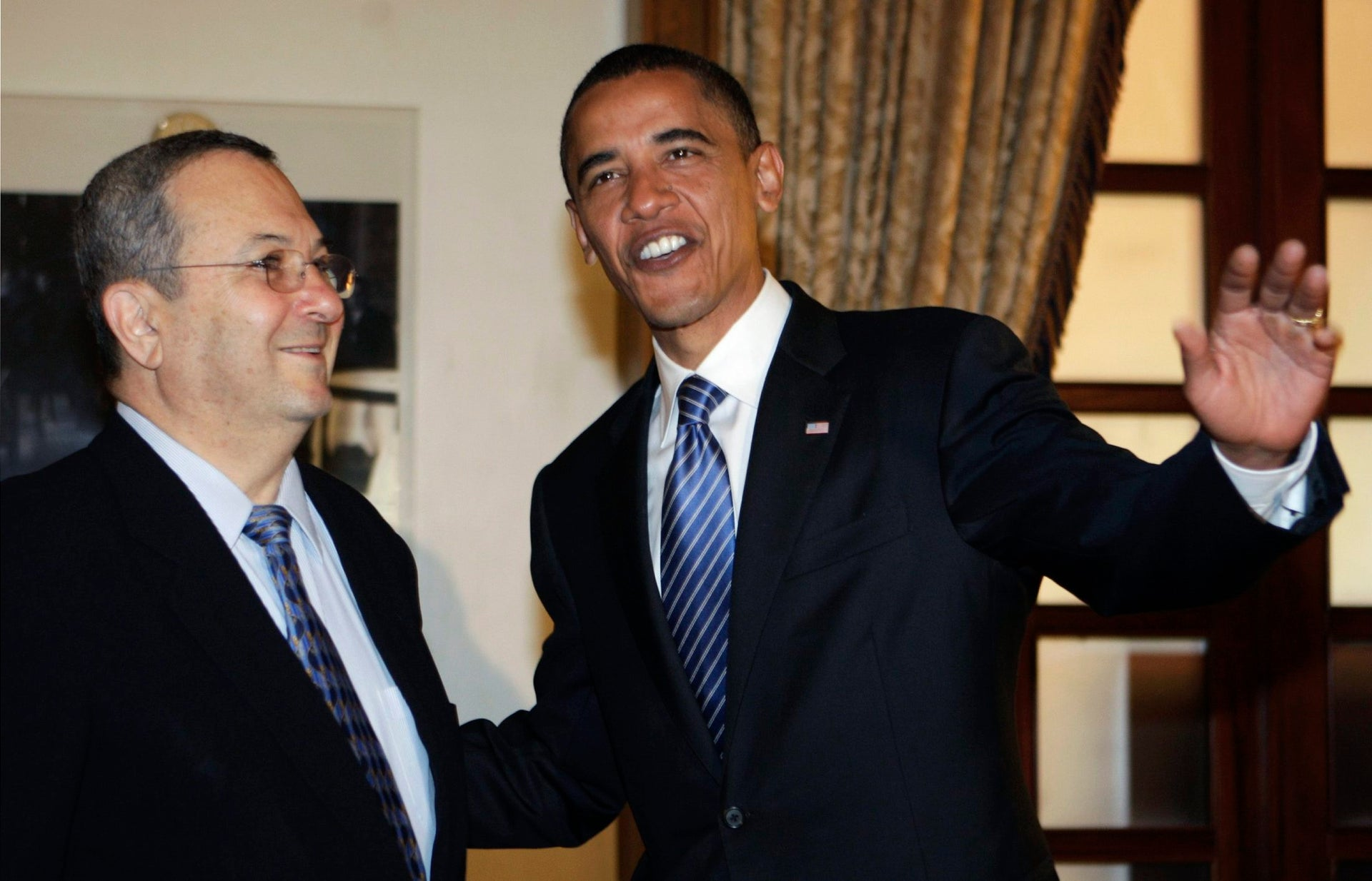 US Democratic presidential contender Barack Obama, right, gestures as he stands with Israeli Defense Minister Ehud Barak, during their meeting at the King David Hotel in Jerusalem, Wednesday, July 23, 2008. Democratic presidential hopeful Barack Obama pledged Wednesday that as president he would preserve the close ties between the United States and Israel, and that the Jewish state's security would be a top priority in his administration. (AP Photo/Eliana Aponte, Pool)