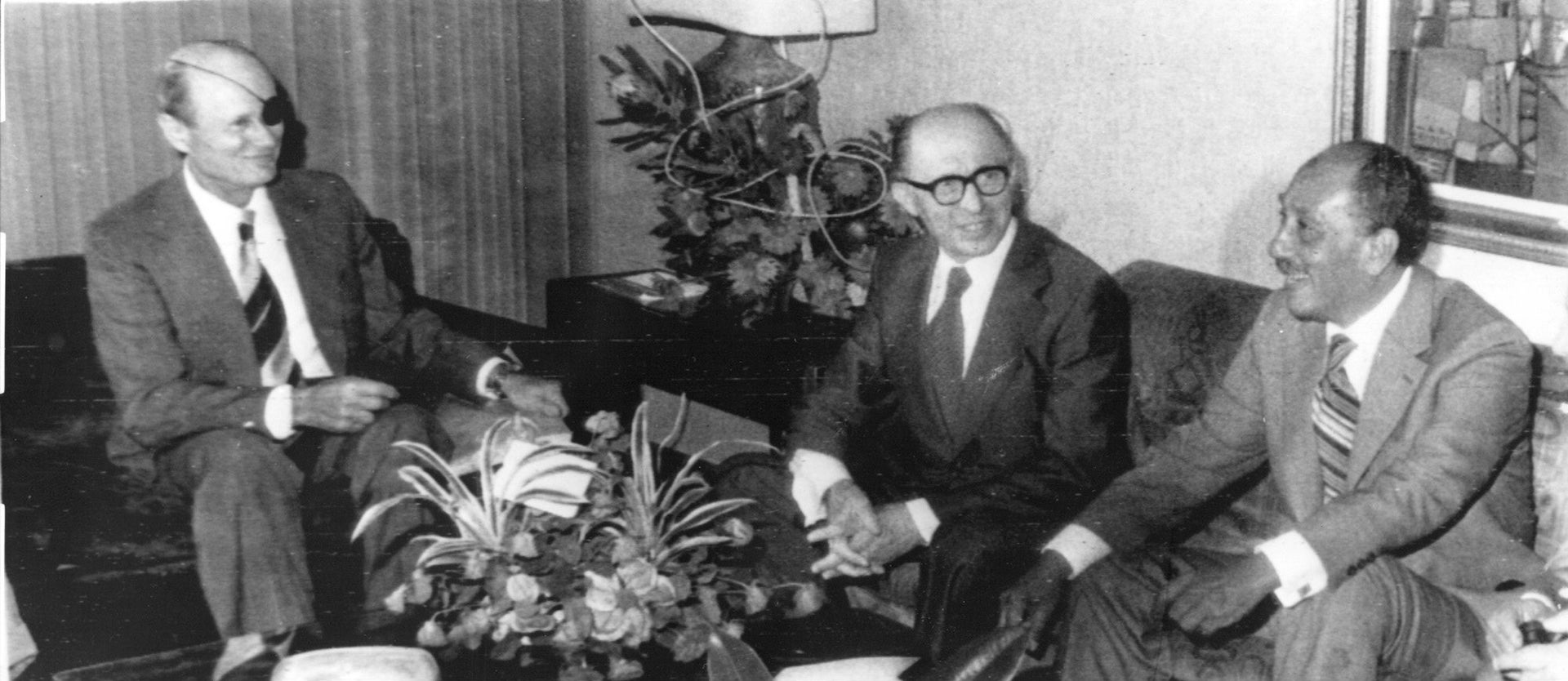 Foreign Minister Moshe Dayan, Prime minister Menahem Begin and Egyptian President Anwar As Sadat (left to right) meet for some talks prior to lunch in the Jerusalem King David Hotel on November 20, 1977, where the Egyptian leader stays during his two-day-visit to Israel.