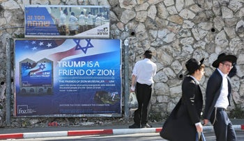 Ultra-Orthodox men pass by a billboard welcoming President Donald Trump ahead of his visit, Jerusalem, May 19, 2017.