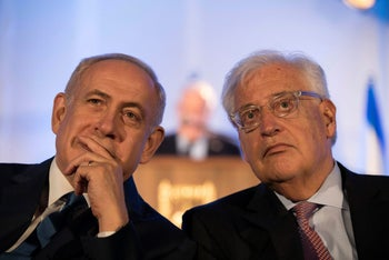 Israeli Prime Minister Benjamin Netanyahu (L) and David Friedman , the new United States Ambassador to Israel attend an event marking the 50th anniversary of Israel's capture of East Jerusalem during the 1967 Six-Day War, opposite the Old City wall and near the Tower of David in Jerusalem May 21, 2017.