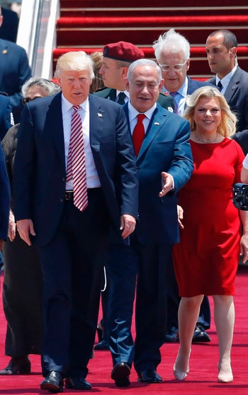 U.S. President Donald Trump being given the red carpet treatment by Prime Minister Benjamin Netanyahu and his wife Sara at Ben-Gurion Airport, May 22, 2017.