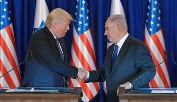 Netanyahu shake hands after delivering press statements prior to an official dinner in Jerusalem on May 22, 2017.