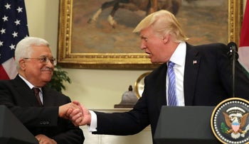 U.S. President Donald Trump shakes hands with Palestinian President Mahmoud Abbas at the White House on May 3, 2017.