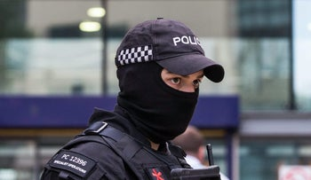An armed police officer stands at Manchester Piccadilly railway station in Manchester, U.K., on Tuesday, May 23.