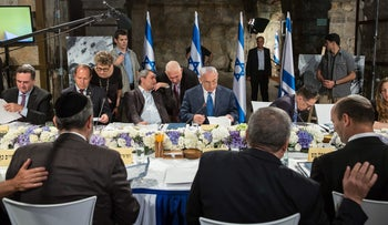 Prime Minister Benjamin Netanyahu convenes the cabinet for its weekly meeting in the tunnels below the Western Wall, May 28, 2017.