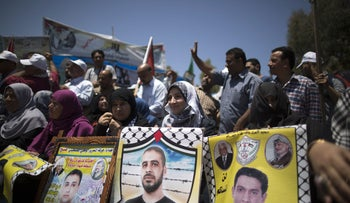 Palestinians taking part in rally in support of Palestinian prisoners held in Israeli jails who ended their hunger strike earlier in the day, in Gaza City on May 27, 2017.