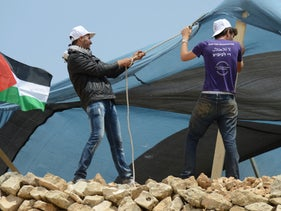 Setting up tents at Sumud: Freedom Camp