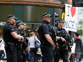 Armed police officers stand on duty in central Manchester, Britain, May 28, 2017.