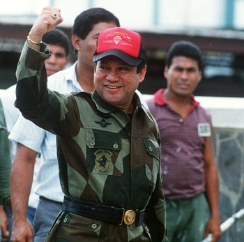 Panamanian dictator General Manuel Noriega waves as he leaves his headquarters in Panama City following a failed coup against him, October 4, 1989.