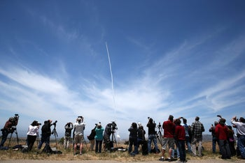 People watch as the Ground-based Midcourse Defense element of the U.S. ballistic missile defense system launches during a flight test from Vandenberg Air Force Base, May 30, 2017.