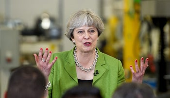 Theresa May, U.K. prime minister and leader of the Conservative Party, speaks to workers during a general-election campaign tour stop at Cross Manufacturing Co 1938 Ltd. in Bath, U.K. on Wednesday, May 31, 2017.