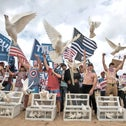 Trump supporters release doves during a march, in Huntington Beach, Calif., on March 25, 2017.