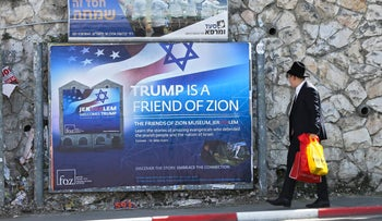 An ultra-Orthodox man passes by a billboard welcoming U.S. President Donald Trump ahead of his visit, Jerusalem, May 19, 2017.