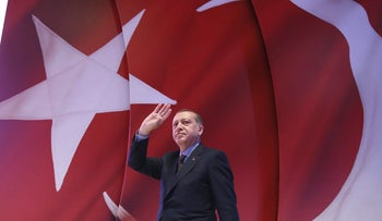 On April 12, 2017, Turkey's President Recep Tayyip Erdogan addresses his supporters during a referendum meeting in Istanbul.