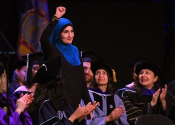 Linda Sarsour taking to the stage at the CUNY Graduate School of Public Health's commencement ceremony, at the Apollo Theater in Harlem, June 1, 2017.