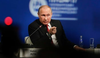 Russian President Vladimir Putin answers a question at the St. Petersburg International Economic Forum in St.Petersburg, Russia, Friday, June 2, 2017.