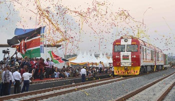 Kenyan President Uhuru Kenyatta flags off a cargo train, as it leaves the container terminal for its inaugural journey to Nairobi, at the port of the coastal town of Mombasa, May 30, 2017