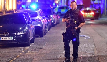 An armed police stands on Borough High Street as police are dealing with an incident on London Bridge in London, Saturday, June 3, 2017.    Witnesses reported a vehicle hitting pedestrians and injured people on the ground.