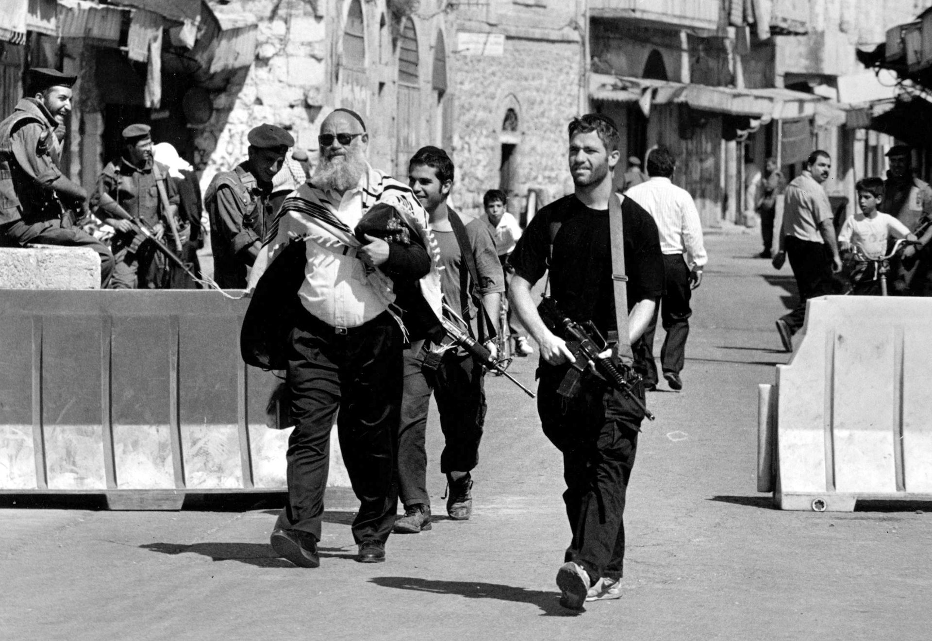 Rabbi Levinger and his bodyguards in Hebron, 1993.