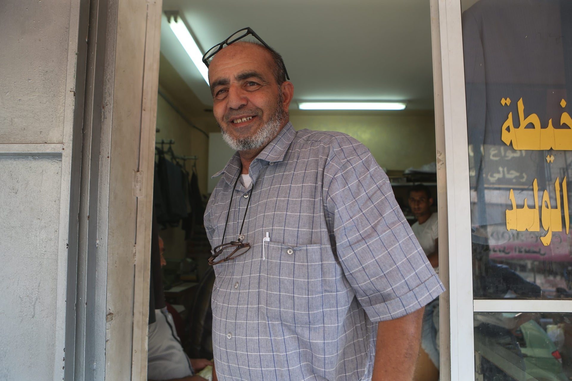 Gazi Kabha regales passersby with tales of life in Barta'a before the Six-Day War.