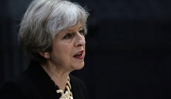 Britain's Prime Minister Theresa May speaks outside 10 Downing Street after an attack that left 7 people dead and dozens injured in London, June 4, 2017.