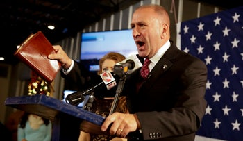 FILE PHOTO: Republican candidate Clay Higgins, with his wife, Becca, addresses supporters after his victory in Louisiana's 3rd congressional district run-off election in Lake Charles, La. December 10, 2016