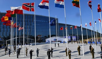 Flags of NATO member countries flutter in Brussels in late May. Today the British flag was flying at half mast.