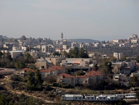 File photo: The West Bank settlement Beit El, with the Palestinian city of Ramallah in the background, January 16, 2017.